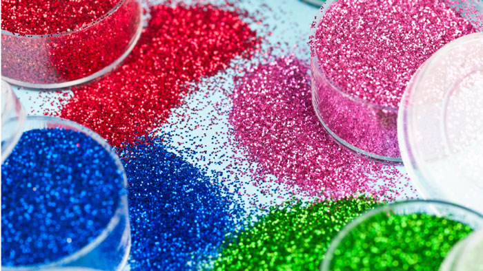 Between Glitter And Embossing Powder